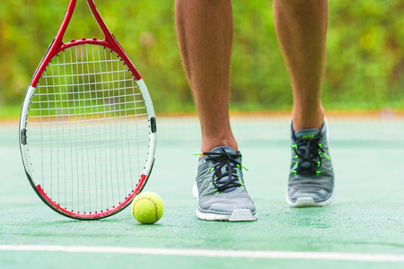 tennis shoe: Close up of sneakers near the tennis racquet and ball Stock Photo
