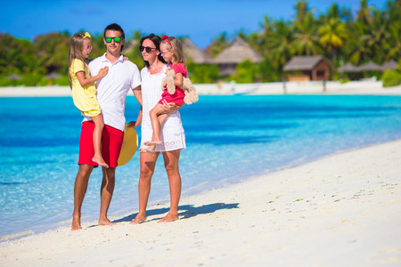 vacation: Happy beautiful family on a beach during summer vacation