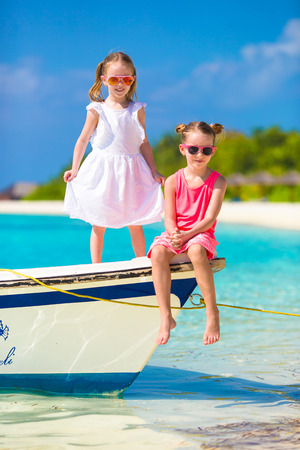 youngbaby: Little adorable girls during tropical beach vacation