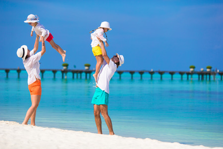 enjoy: Happy family during beach vacation
