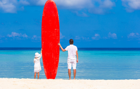little girl beach: Little girl and young dad with surfboard during summer vacation