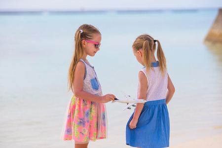 Adorable little girls on beach during summer vacation photo