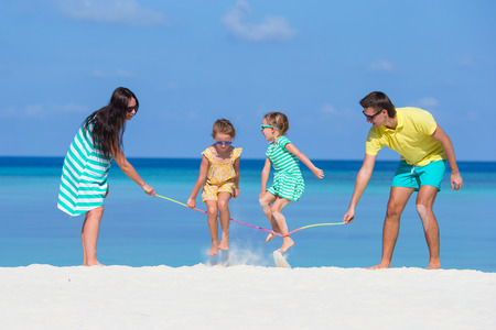 family beach: Happy family playing together on white beach Stock Photo
