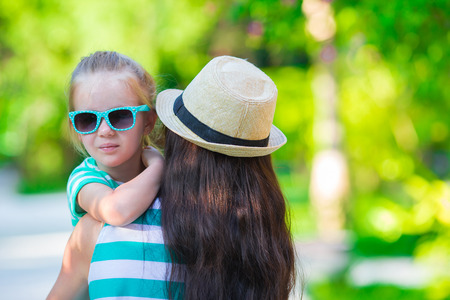 adult beach: Little girl and young mother during beach vacation Stock Photo