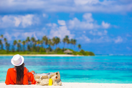 loungers: Beautiful young woman relaxing at beach