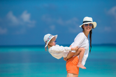 Little girl and young mother during beach vacation Stock Photo
