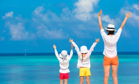 mom: Little girls with mom have fun during tropical vacation
