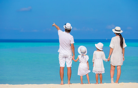 vacation: Beautiful tropical beach landscape with family in white enjoying summer vacation