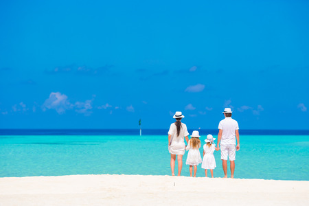 caribbean: Beautiful tropical beach landscape with family in white enjoying summer vacation
