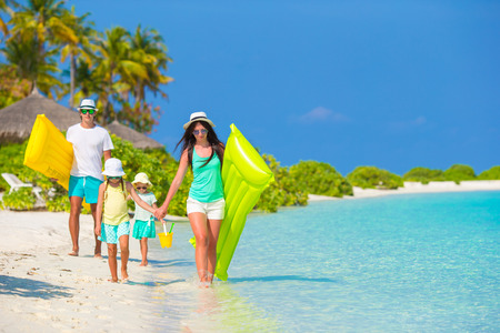 caribbean: Young family of four on beach vacation