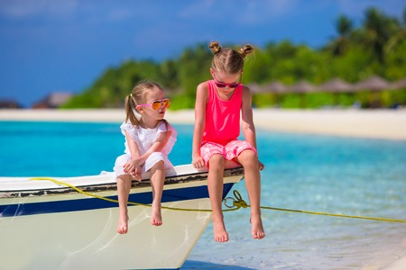 Adorable little girls during summer tropical vacation photo