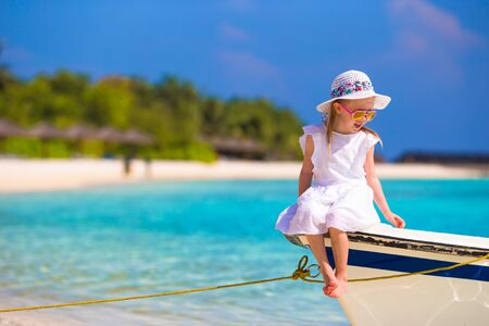 kids playing: Adorable happy smiling little girl on boat in the sea