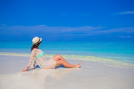 holiday destination: Young woman enjoy tropical beach vacation Stock Photo