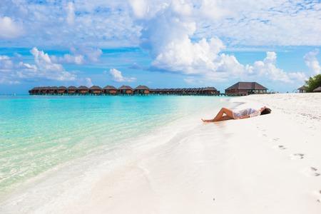 Young slim woman enjoy tropical beach vacation