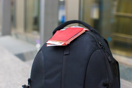 Closeup passports and boarding pass on backpack at airport photo