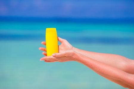 suncream: Closeup suncream bottle background blue sea Stock Photo