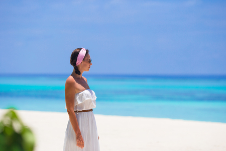 caribbean: Young happy woman on white sandy beach