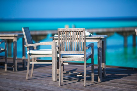 Summer empty outdoor cafe at exotic island in indian ocean photo