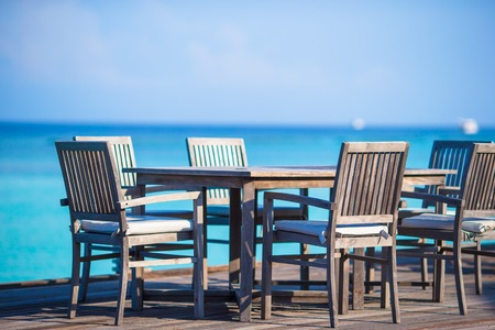 Summer empty outdoor cafe on exotic shore photo