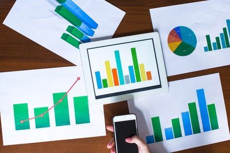 training and development: Business chart showing financial success on paper