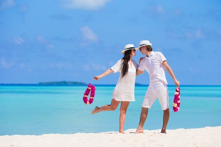 vacation destinations: Young happy couple during beach tropical vacation
