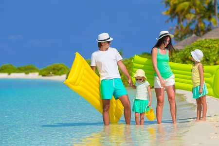 Happy beautiful family on a tropical beach holiday