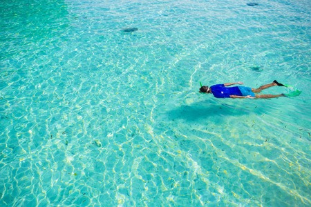 turquoise: Man snorkeling in tropical water on vacation