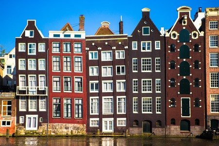 canal house: Medieval cute houses in Amsterdam the Netherlands Stock Photo
