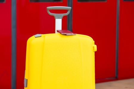 baggage train: Closeup passports on yellow baggage at train station