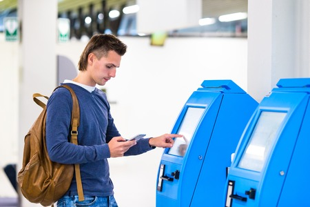 Closeup display at self-service transfer machine, doing self-check-in for flight or buying airplane tickets at airport Stock Photo