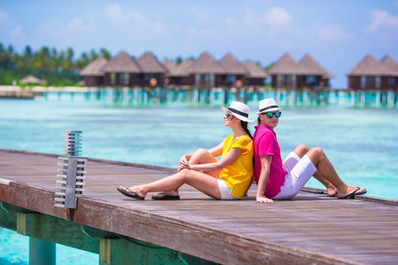 honeymoon couple: Couple on a tropical beach jetty at Maldives Stock Photo
