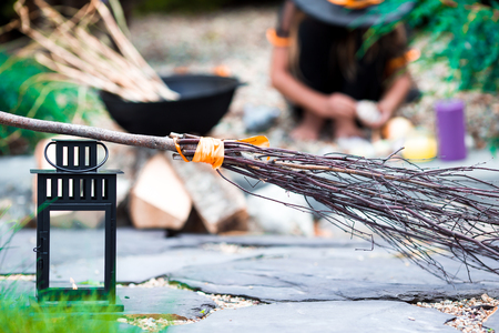cucurbit: View of Halloween Pumpkins, witchs hat and rake outdoor Stock Photo