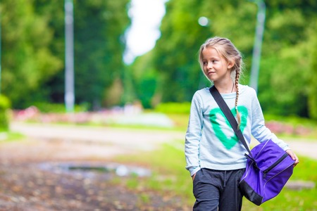 child sport: Little girl goes to the gym with her sports bag