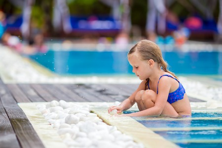 little girl swimsuit: little girl enjoy vacation in the swimming pool