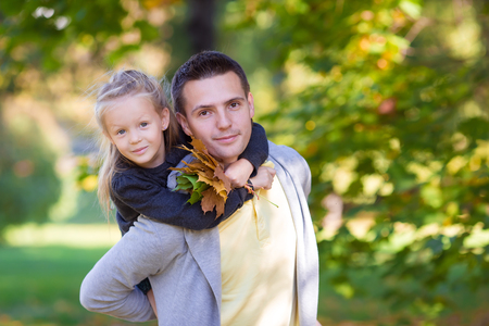 kiss love: Father with cute daughter in autumn park outdoors