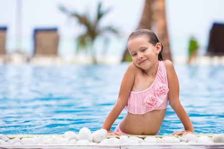 Closeup little girl having fun in outdoor swimming pool Stock Photo