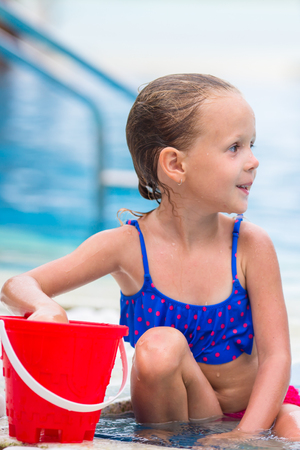 swimsuits: little girl enjoy vacation in the swimming pool