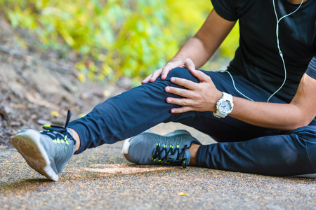 Male athlete suffering from pain in leg while exercising outdoor Stock Photo - 47193208