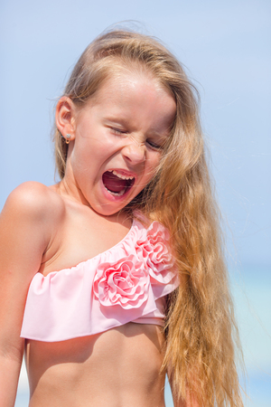 child swimsuit: little girl enjoy vacation in the swimming pool