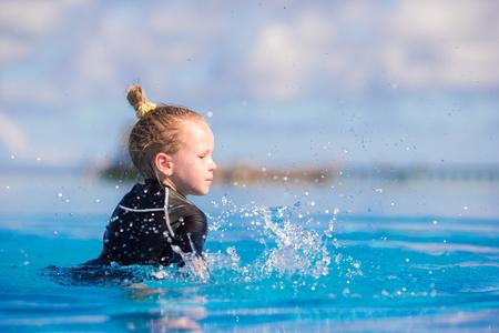 little girl swimsuit: little girl enjoy vacation in the swimming pool