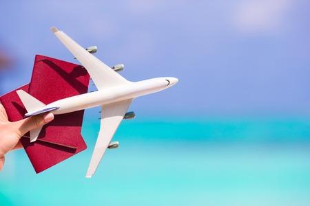 Closeup of man holding passports and airplane