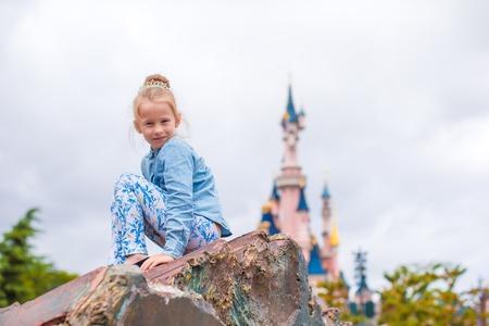 petrovka: Little happy girl in fairy-tale park Disneyland