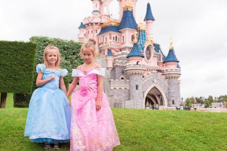 Little happy girls in fairy-tale park Disneyland Éditoriale