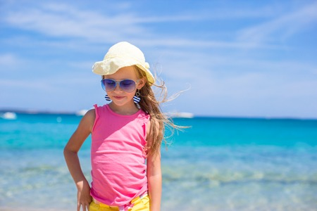 toddler walking: Adorable little girl at tropical white beach