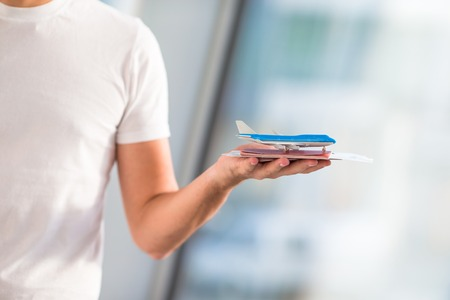 Close up passports and boarding pass at airport indoor background airplane