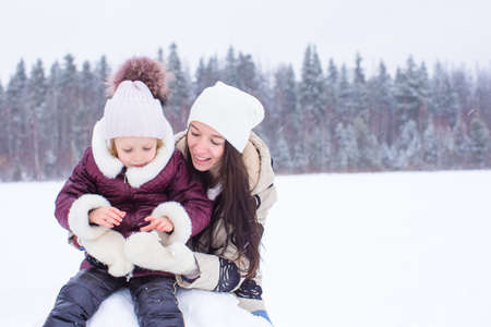 snowballs: Happy family playing snowballs in the winter snowy day