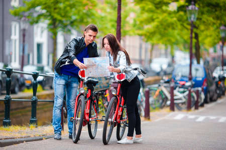 dutch girl: Young tourists couple looking at map in european city, Amsterdam, Holland Stock Photo