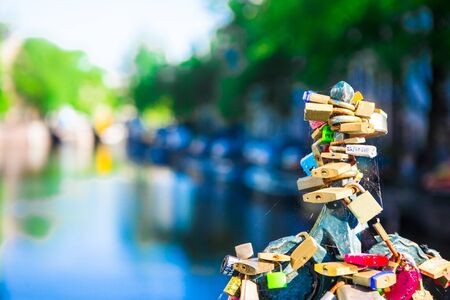 hundreds: Hundreds of padlocks on bridge in Amsterdam, Netherlands Stock Photo