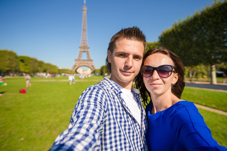 champ: Young happy couple on the Champ de Mars in Paris background the Eiffel Tower, France