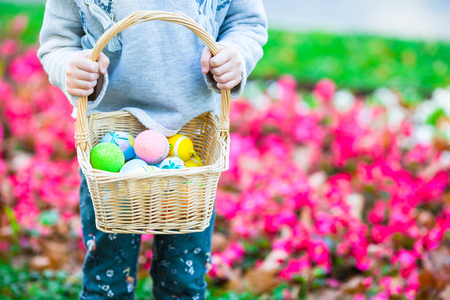 egg plant: Child holding a basket with easter eggs Stock Photo